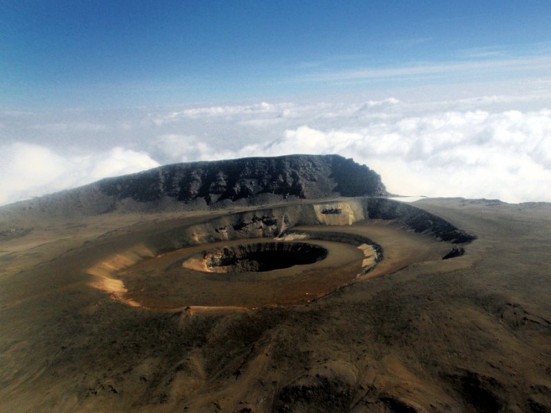 crater at the top of kilimanjaro tanzania africa blue sky and clouds