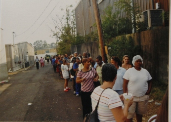 long line of hurricane katrina victims waiting for Red Cross assistance