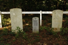 small graveyard, whitewashed fence, 3 tombstones